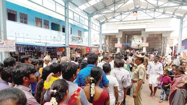 People wait for hours outside the Thirunallar Temple Entrance on a Saturday